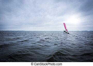 Windsurfer on a big lake