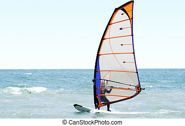 Windsurfer on the sea in the afternoon