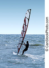 Windsurfer on waves of a sea 2