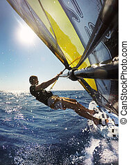 Windsurfing in sea with splashing water