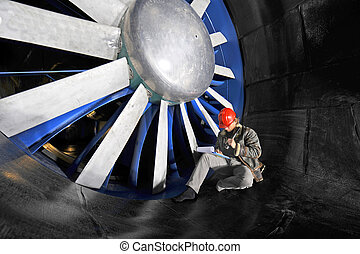 Windtunnel mainenance worker - An engineer working through a...