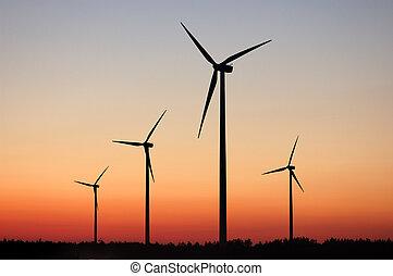 Windturbines against dramatic sunset