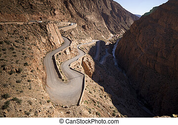 windy mountain road in the dades gorge morocco - a windy...