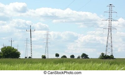high tension wires - windy rural landscape with high tension...