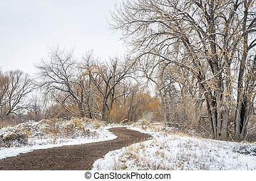 windy trail in fall or winter scenery in one of natural ...