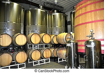 Storing and aging of wine in stainless steel containers and oak barrels.