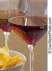 Wine and appetizer - Closeup of glasses of wine and ...