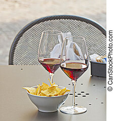 Wine and appetizer - Closeup of glasses of wine and...