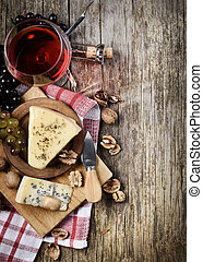 Wine and cheese - Glass of red wine and cheese on rustic ...
