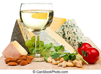 Wine and cheese - Glass of white wine with various types of ...