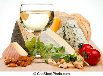 Wine and cheese - Glass of white wine with various types of...
