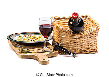 wine and cheese snack on wooden planch