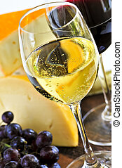 Wine and cheese - Wineglasses with red and white wine and ...