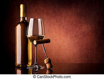 Wine and corkscrew - White wine and corkscrew on a vinous...