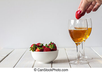 Wine and Dropping Strawberries in Glass on Table with Copy Space
