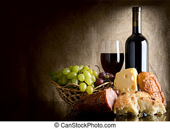 Wine and food - Wine, cheese, grapes and sausage on an old...