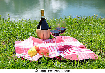 Wine and fruits served at a picnic on Alpine meadow. Switzerland