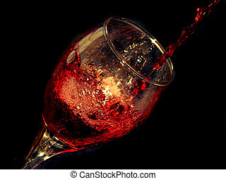 wine and glass - red wine being poured in a glass