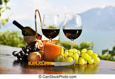 Wine and grapes against Geneva lake. Lavaux region, Switzerland
