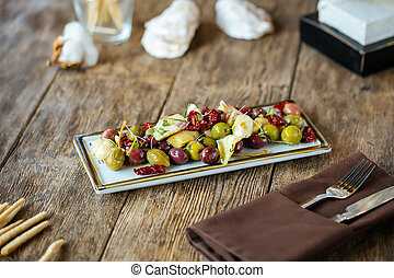 Wine appetizers olives artichokes and tomatoes