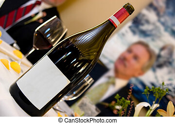 wine at restaurant - bottle of wine with blank label and man...