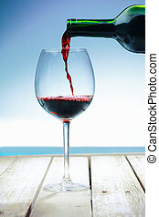 Wine at the beach on a deck in front of the ocean