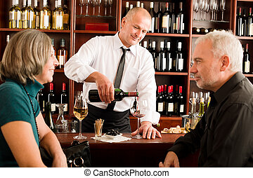 Wine bar senior couple barman pour glass - Wine bar senior...