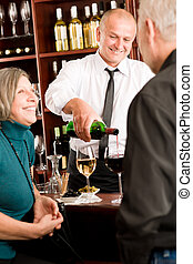 Wine bar senior couple barman pour glass - Wine bar senior ...