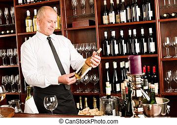 Wine bar waiter happy male in restaurant - At the bar - ...