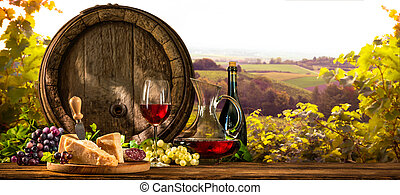 Wine barrel on vineyard - Barrel with glas of red wine and...