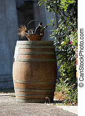 wine barrel with a bottle and glass