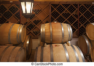 Wine Barrels and Bottles in Cellar - Wine Barrels and...