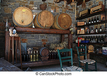 Wine barrels and bottles in the old cellar of a winery. -...