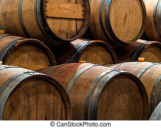 nfor a winery standing barrels with wine in wine cellar.