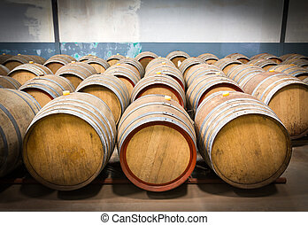 Wine barrels in the cellar of the winery,Wine barrels in...