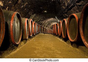 Wine barrels in winery cellar - Old wine barrels are stored ...