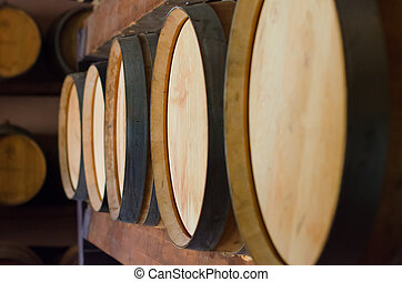 Wine barrels stacked in the cellar.