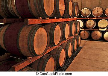 Wine barrels - Stacked oak wine barrels in winery cellar