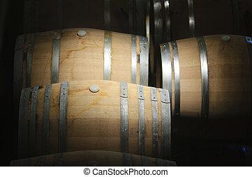 Wine Barrels - Wine barrels in a dark cavern while wine...