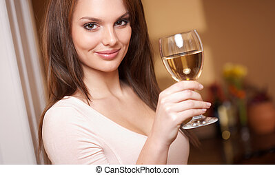 Wine beauty. - Brunette beauty enjoying a glass of white...
