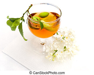 Wine berry flowers - Branch with plum in a wine-glass with a...
