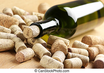 Wine bottle and corks - Closed wine bottle and heap of used...