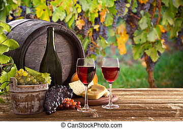 Wine bottle and glasses on wooden table - Wine bottle and ...