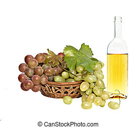 Wine bottle and grapevines in basket