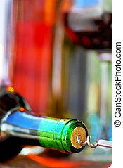 Wine Bottle closeup and corkscrew.