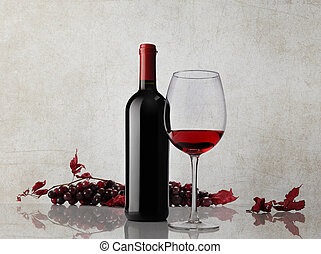 wine bottle glass bunch of grapes on marble background