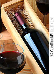 Wine bottle in box with wineglass