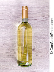 Wine bottle on wooden background