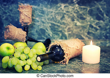 wine bottle with glass and white grape