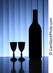 Wine bottle with two glasses, dramatic light, copy-space for...